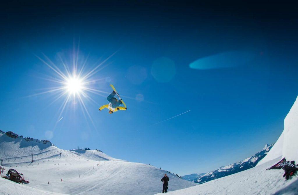 drone follows snowboarding